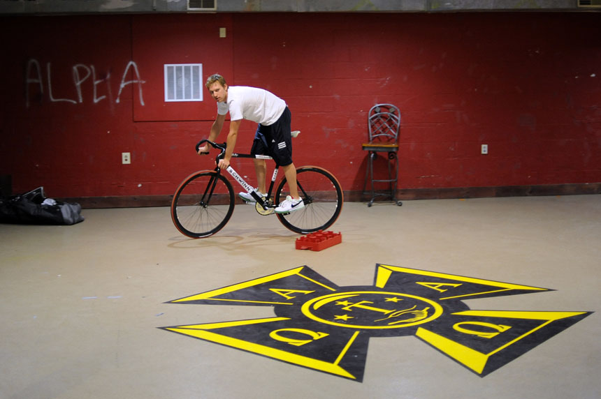 Emanon rider Alex Ray takes a team bicycle for a spin in the basement of the Alpha Tau Omega house on Wednesday, April 21, 2010, in Bloomington, Ind. The team met at the house to do a few last-second tweaks to their bicycles before turning it in for pre-race inspection the next day.