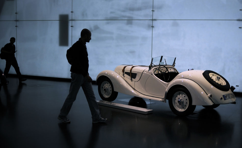 Visitors make their way past a 1936 BMW 328 on Monday, May 24, 2010, in the BMW Museum in Munich, Germany.