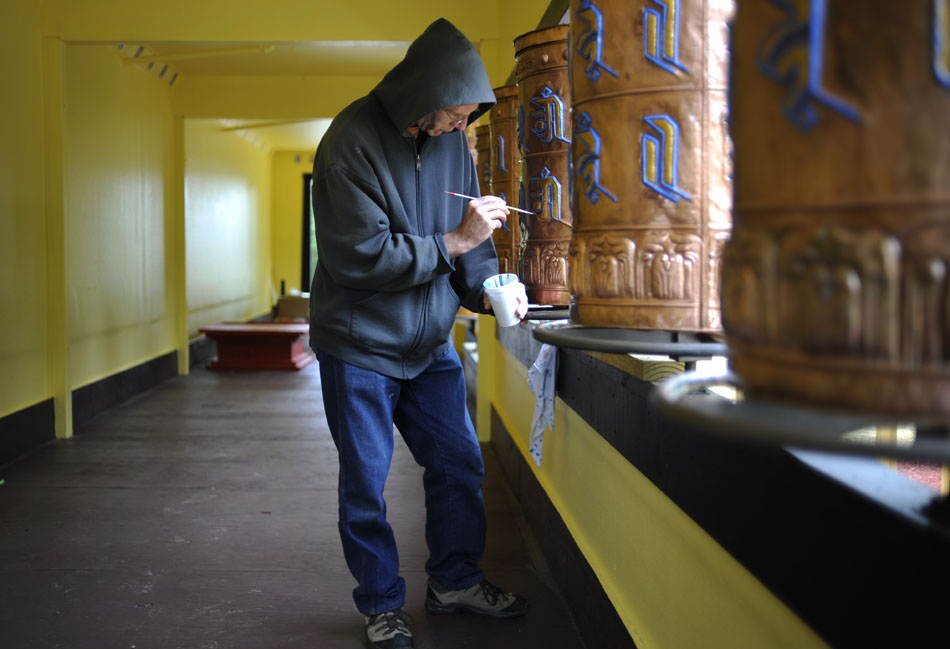 Artisan Ron Roberts works on a Mani Khorlo prayer wheel in a new structure on Saturday 8, 2010, at the Bloomington Tibetan Mongolian Buddhist Cultural Center. Monks and volunteers are preparing the cultural center for a visit from the Dalai Lama on May 12 and 14.