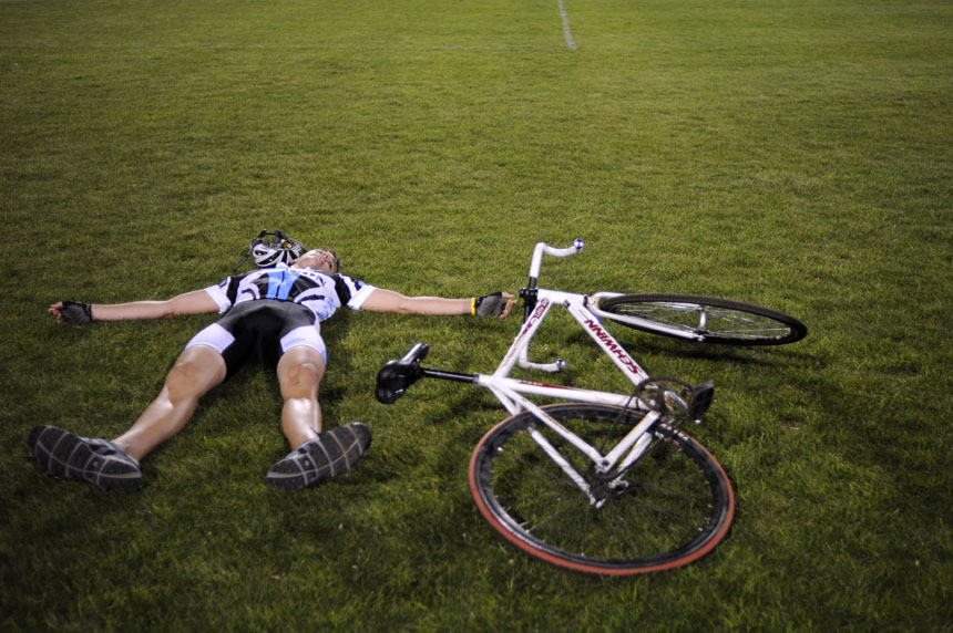 Emanon rider Justin Haviar collapses on the ground after making his way back to the turn three side of the infield after his Little 500 Individual Time Trial on Wednesday, March 31, 2010, at Bill Armstrong Stadium.
