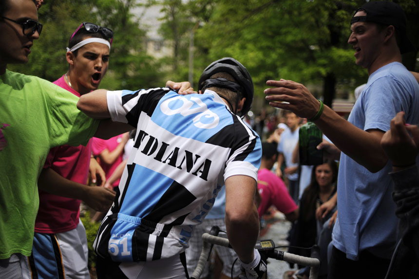Fans high-five and attempt to hug Emanon rider Elliot Englert during a race-day send off for the team on Saturday, April 24, 2010, from the Alpha Tau Omega house.