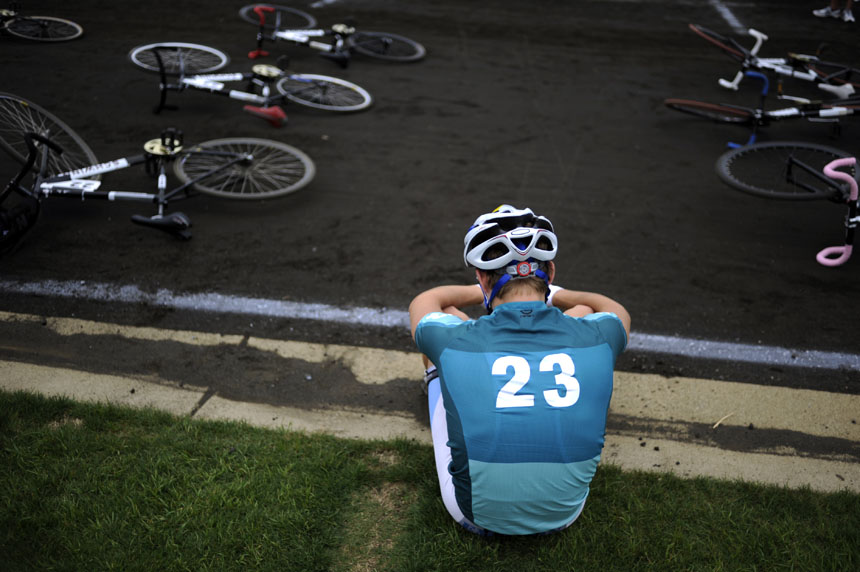 Emanon rider Alex Ray takes a moment to himself sitting on the gutter of the track during pre-race festivities before the start of the 60th Men's Little 500 on Saturday, April 24, 2010, at Bill Armstrong Stadium.