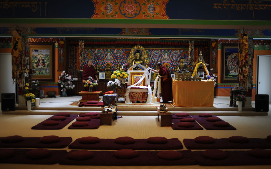 Monks retreve Khatas, a type of ceremonial scarf, from an alter in the main temple on Saturday, May 8, 2010, at the Tibetan Mongolian Buddhist Cultural Center. Khatas are presented to dignitaries arriving to see the Dalai Lama in Bloomington on May 12 and 14.