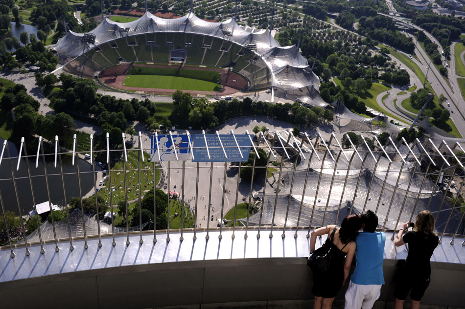 Visitors look down into the Olympic Stadium from a viewing platform on the Olympic Stadium on Monday, May 24, 2010, in Munich, Germany. The Olympic park hosted the 1972 Summer Olympics.