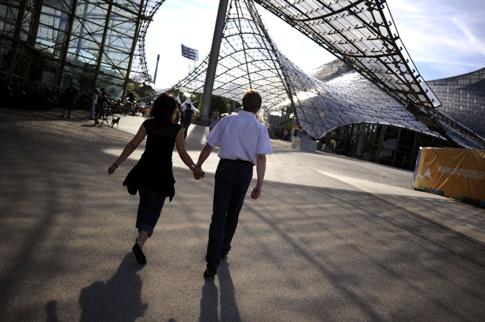 A couple walks through the Olympic Park on Monday, May 24, 2010, in Munich, Germany.