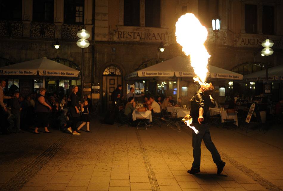 A fire breather performs outside the Augustiner Beer Hall on Monday, May 24, 2010, in Munich, Germany.