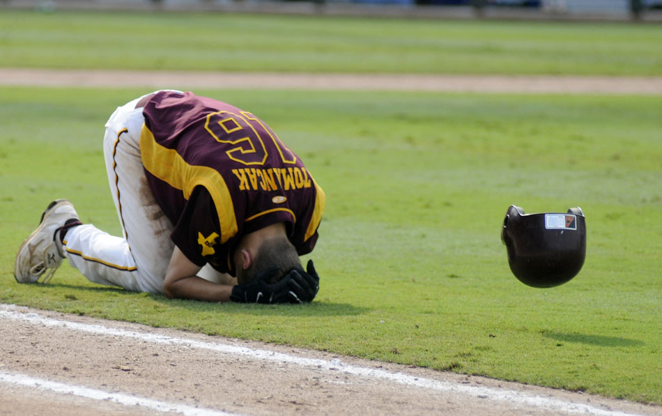 Thorndale's Calvin Tomancak drops to his knees halfway to first base after committing the final out in a 5-4 loss to Evadale in a Class 1A baseball semifinal at Dell Diamond in Round Rock on Wednesday, June 9, 2010.