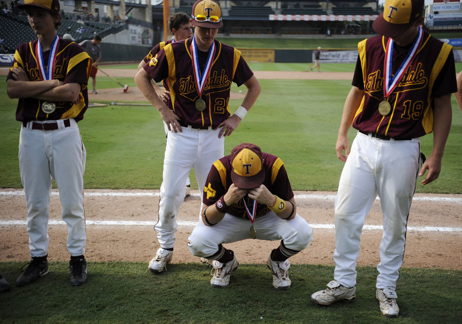 Thorndale's Weston Fisher, middle, puts his head in his hands after a heartbreaking 5-4 loss to Evadale in a Class 1A semifinal at Dell Diamond in Round Rock on Wednesday, June 9, 2010.