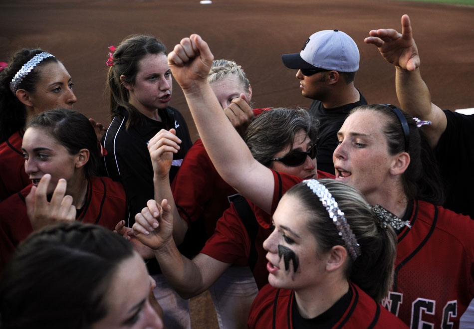 Bowie players huddle up before the start of a Class 5A softball semifinal against Tomball at the University of Texas on Friday, June 4, 2010.