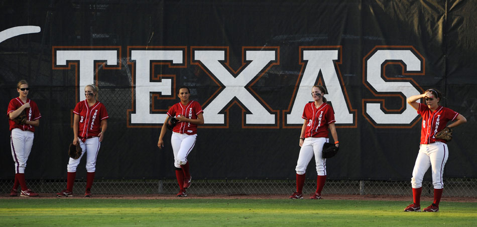 Tomball players warm up in the outfield before a Class 5A softball semifinal against Bowie at the University of Texas on Friday, June 4, 2010.