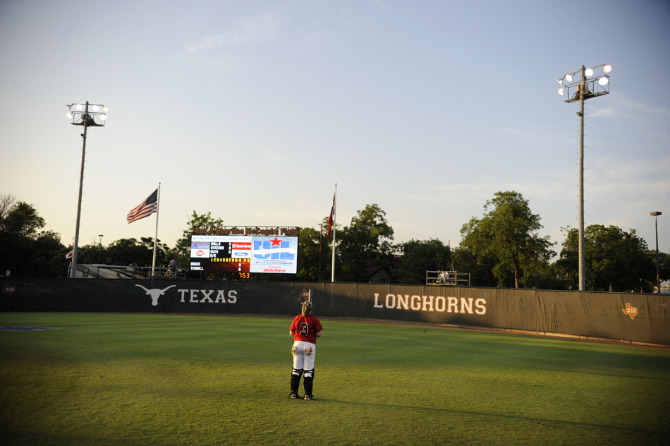 Bowie catcher Jaime Edwards takes a moment to herself alone in the outfield before a Class 5A softball semifinal against Tomball at the University of Texas on Friday, June 4, 2010.