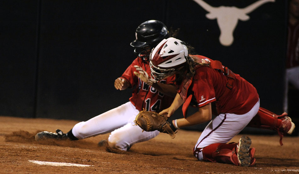 Bowie's Alli Akina slides into home as Tomball's Katie Doerre applies the tag during a Class 5A softball semifinal at the University of Texas on Friday, June 4, 2010.