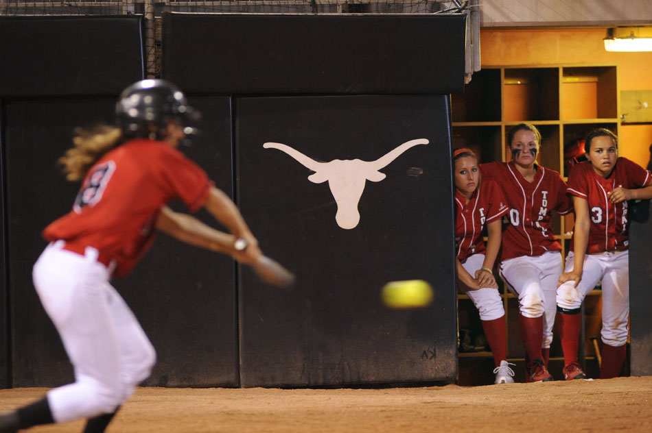 Tomball players watch as Bowie's Jillian Guerrero connects with a pitch during a Class 5A softball semifinal at the University of Texas on Friday, June 4, 2010. Bowie won 9-1.