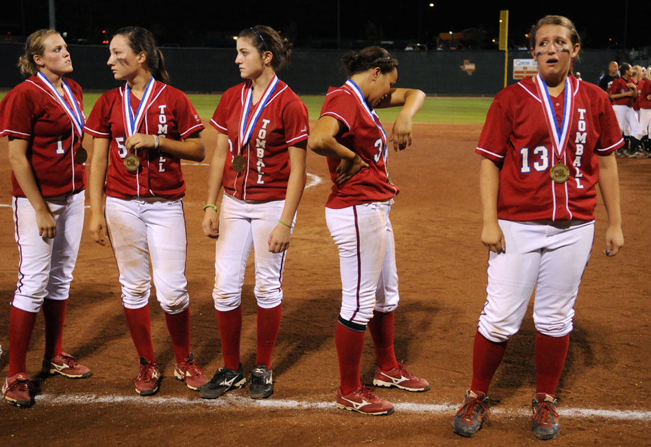 Tomball players show their disappointment after falling to Bowie 9-1 in the Class 5A softball semifinal at the University of Texas on Friday, June 4, 2010.