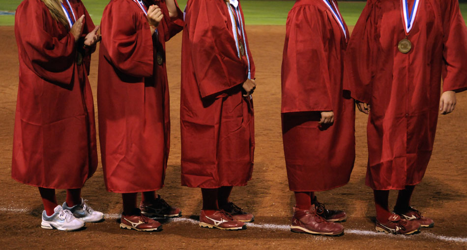 Tomball players line up on the third base line for a mock graduation ceremony after a 9-1 loss to Bowie in the Class 5A softball semifinal game at the University of Texas on Friday, June 4, 2010. The game conflicted with the school's commencement ceremonies so players received their diplomas after the game at home plate.
