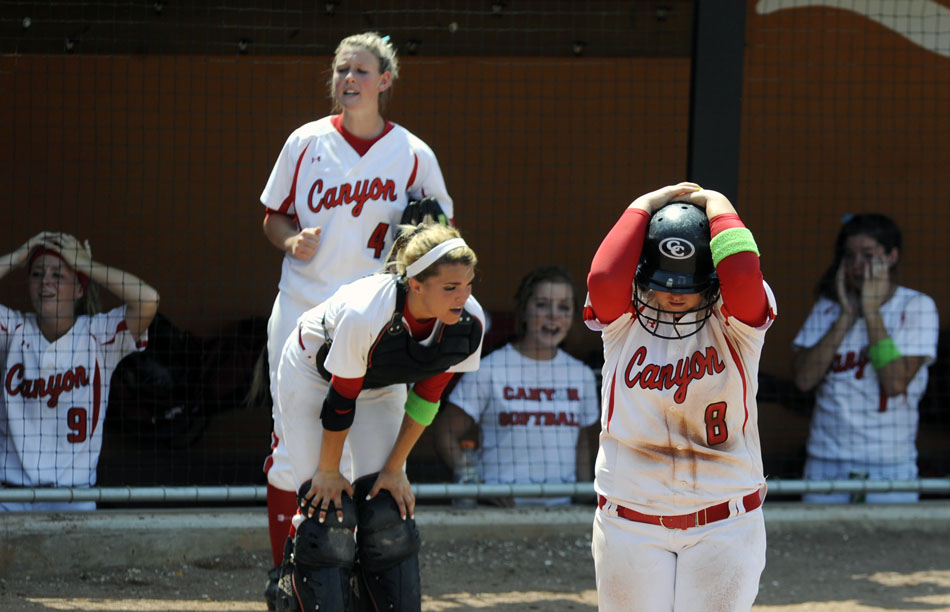 Canyon's Aby Kester (8) hangs her head after a Canyon score in the bottom of the 9th inning was called back after a hit fell foul during a 4A softball semifinal against Magnolia at the University of Texas on Friday, June 4, 2010.