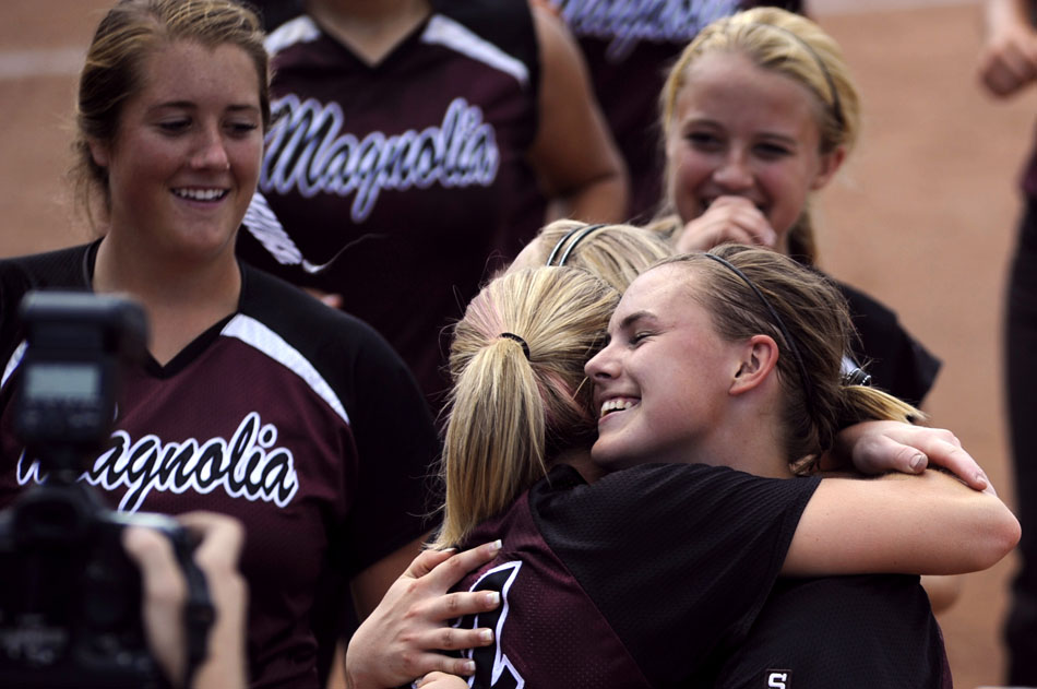 Magnolia's Kassi Mushinski, right, hugs teammate Katy Adair after the team defeated Canyon in a 4A softball semi-final at the University of Texas on Friday, June 4, 2010.