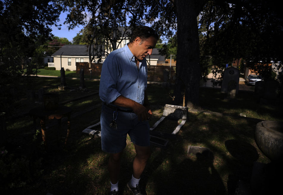 Dale Flatt, an organizer with Save Austin's Cemeteries, walks through an older area of Oakwood Cemetery on Wednesday, June 23, 2010. Flatt, a Austin firefighter, works to preserve and restore old headstones and grave sites through the organization.