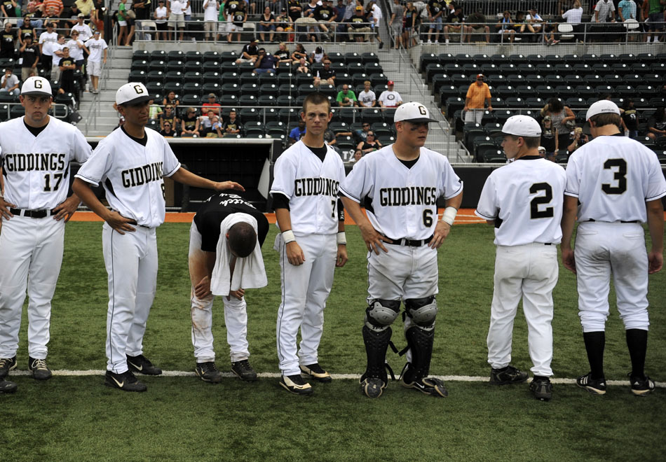 Giddings pitcher Ty Marlow, third from left, shows his disappointment after a 2-0 loss to Pleasant Grove in the Class 3A state championship game at Disch-Falk Field on Thursday, June 10, 2010.