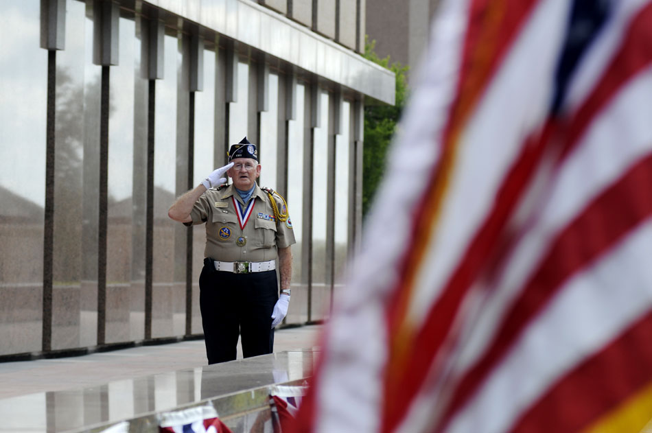 "Andrew ""Buddy"" Blair, a Korean War veteran, salutes the flag during a ceremony marking the 60th Anniversary of the start of the Korean War at the Texas Korean War Veterans Memorial on Friday, June 25, 2010."