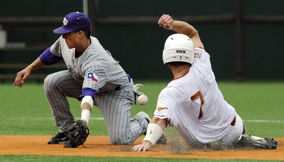 Texas' Jordan Etier slides safely into second base as a throw gets away from TCU's Jerome Pena during a NCAA Super Regional at Disch-Falk Field on Friday, June 11, 2010.