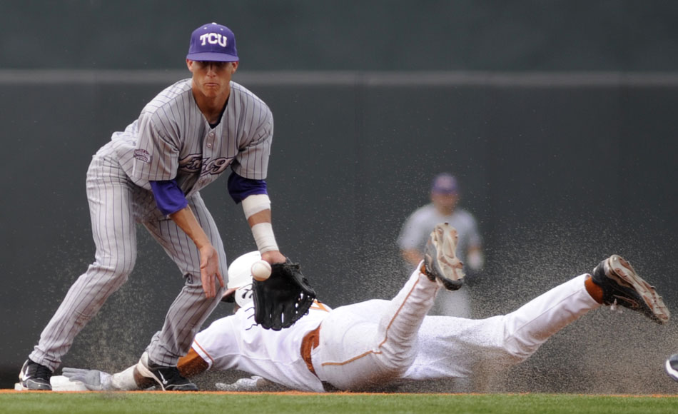 Texas' Kevin Keyes slides safely into second in front of a throw to TCU's Jerome Pena during a NCAA Super Regional at Disch-Falk Field on Friday, June 11, 2010.