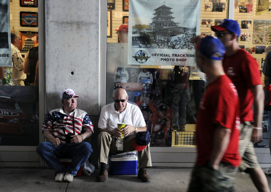 James Gill, left, and Charles Edwards both of Louisville, Ky., take a break under the main grandstands during the 93rd Indianapolis 500 on Sunday May 24, 2009, at the Indianapolis Motor Speedway in Speedway, Ind.