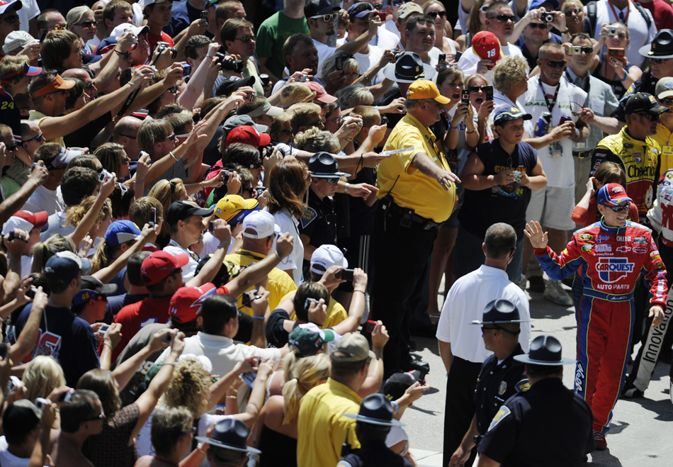 Pole sitter Mark Martin, far right, waves to fans as he makes his way into the pagoda for driver introductions before the start of the Brickyard 400 on Sunday, July 26, 2009, at the Indianapolis Motor Speedway.