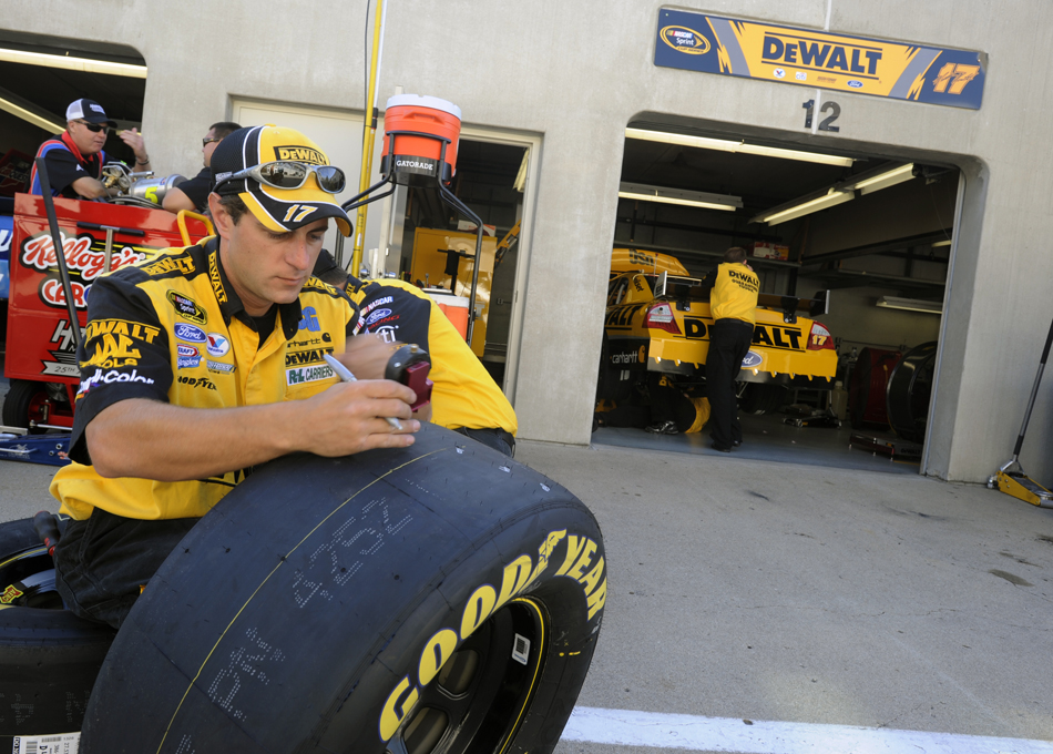 A member of Matt Kenseth's crew checks tire tread before the start of the Brickyard 400 on Sunday, July 26, 2009, at the Indianapolis Motor Speedway.