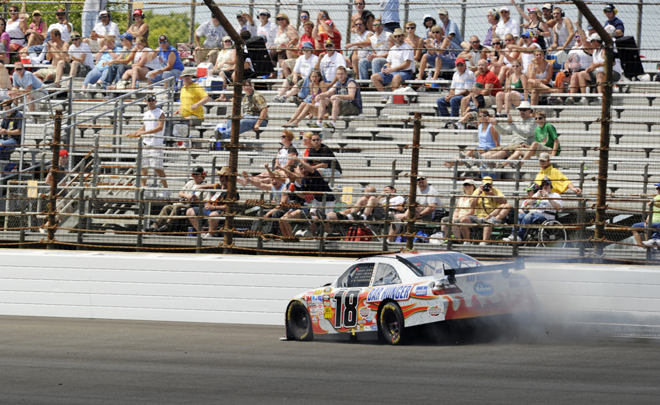 Kyle Busch crashes into the wall in turn three during Brickyard 400 on Sunday, July 26, 2009, at the Indianapolis Motor Speedway. Busch's crash triggered cheers from the crowd.