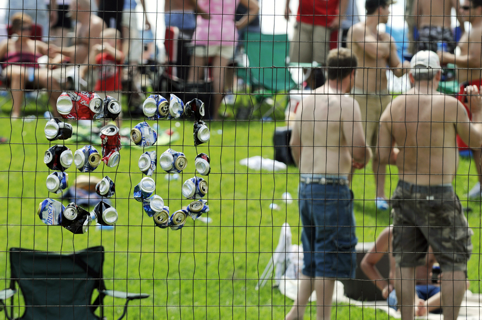 The number 88, for driver Dale Earnhardt Jr., is spelled into a fence using crushed beer cans during the Brickyard 400 on Sunday, July 26, 2009, at the Indianapolis Motor Speedway.