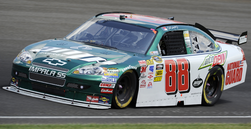 Driver Dale Earnhardt Jr. drives into turn three during Brickyard 400 on Sunday, July 26, 2009, at the Indianapolis Motor Speedway.
