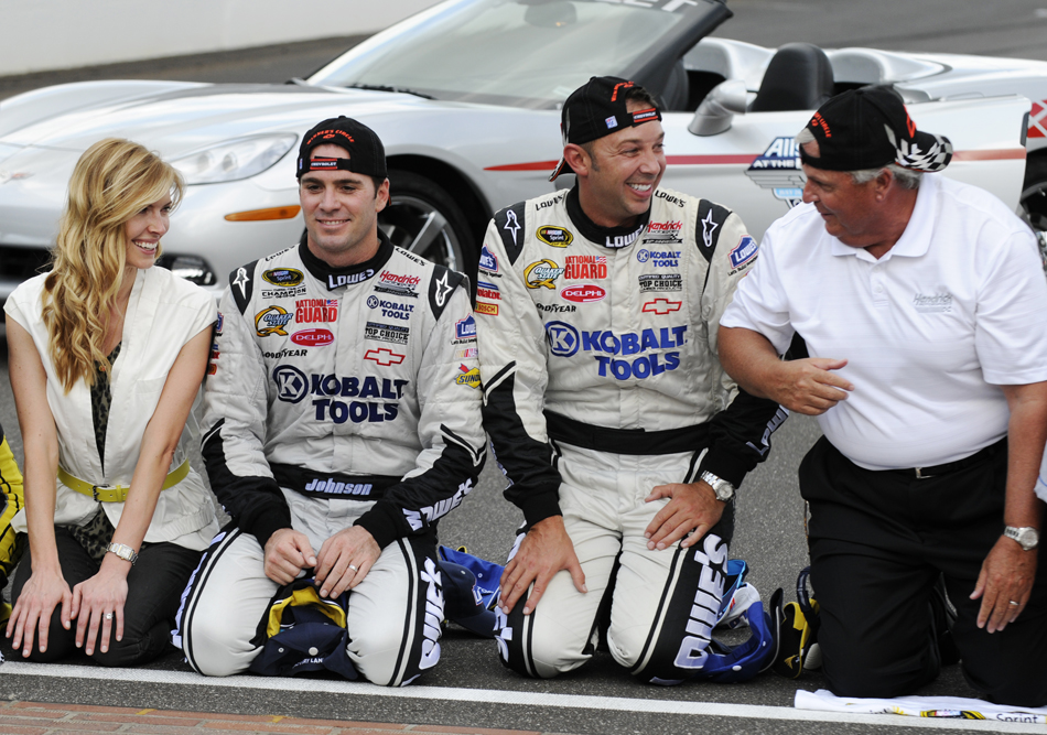Crew chief Chad Knaus, second from right, shares a laugh with car owner Rick Hendrick, right, Chandra Johnson, left, and Jimmy Johnson, the winning driver, after Johnson won the Brickyard 400 on Sunday, July 26, 2009, at the Indianapolis Motor Speedway.