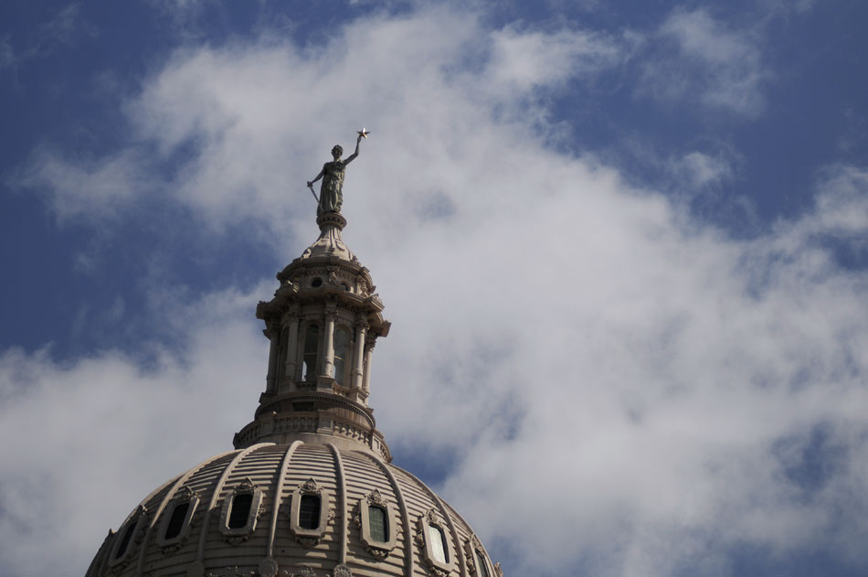 Clouds spot the sky behind the top of the Texas State Capitol as temperatures reached the 90s on Wednesday, July 14, 2010.