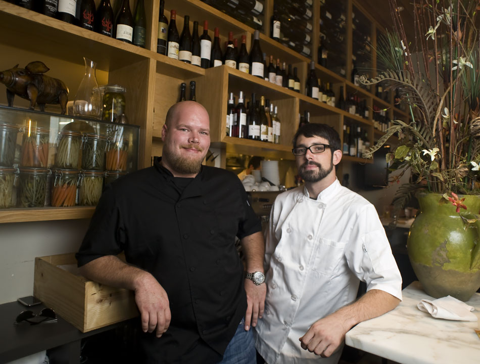 Mulberry chef Zack Northcutt, left, and sous chef Jacob Weaver pose for a portrait in front of the restaurant's vast wine selection on Tuesday, July 20, 2010. 0805xldine