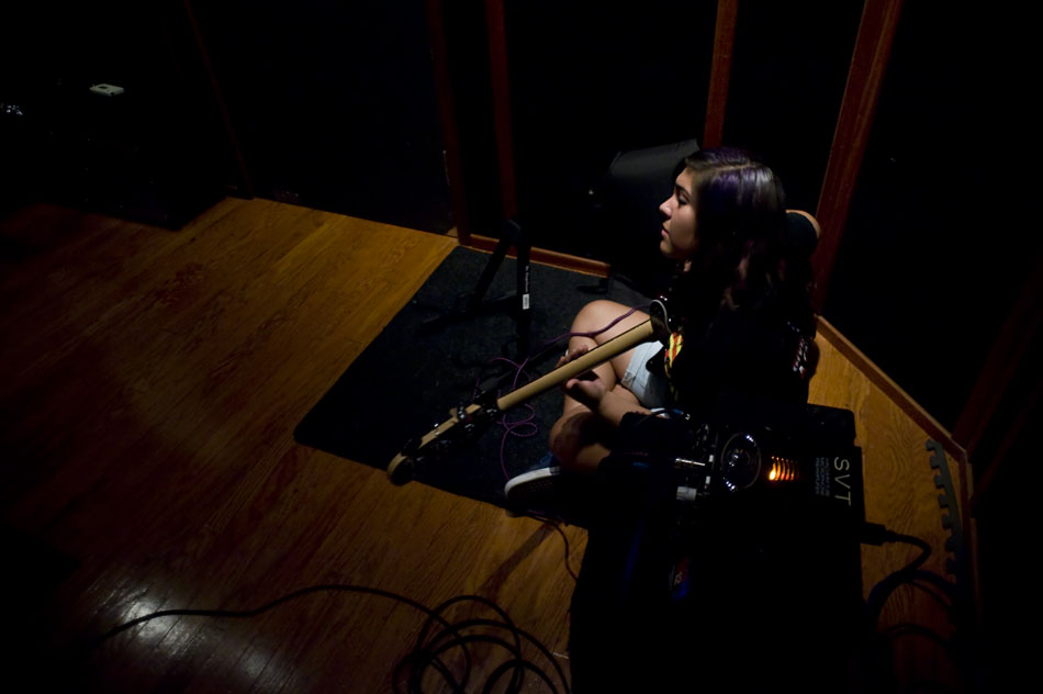 The Explosion of the Minds bassist Mercedes Salazar sits in the corner of a recording studio with her bass guitar as she waits for her group to start a recording session during Rock Camp USA at the Austin School of Music on Wednesday, July 21, 2010.