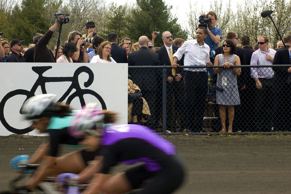 Presidential hopeful Sen. Barack Obama, D-Ill., watches pace laps with Indiana University Student Foundation director Jenny Bruffey, right, before the start of the women's Little 500 bicycle race on Friday, April 11, 2008, at Bill Armstrong Stadium. Obama walked around the track and greeted each team before the  race.