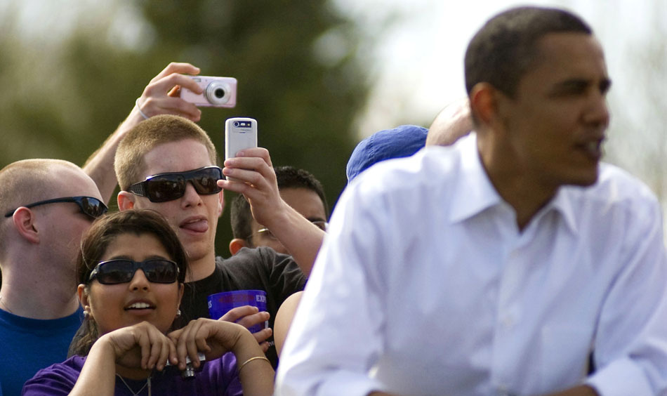 Fans take pictures of presidential hopeful Sen. Barack Obama, D-Ill., before the start of the Women's Little 500 bicycle race Friday, April 11, 2008, at Bill Armstrong Stadium. Obama made a surprise visit to town and stayed for the opening laps of the race.