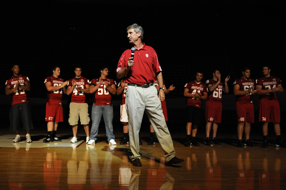 Flanked by freshmen football players, IU football coach Bill Lynch talks to students during Traditions and Spirit of IU on Friday, Aug. 28, 2009, at Assembly Hall.