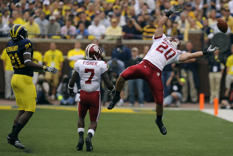 IU safety Austin Thomas, No. 20, watches as a possible interception goes through his hands during a football game against Michigan on Saturday, Sept. 26, 2009, in Ann Arbor, Mich. IU lost 36-33.