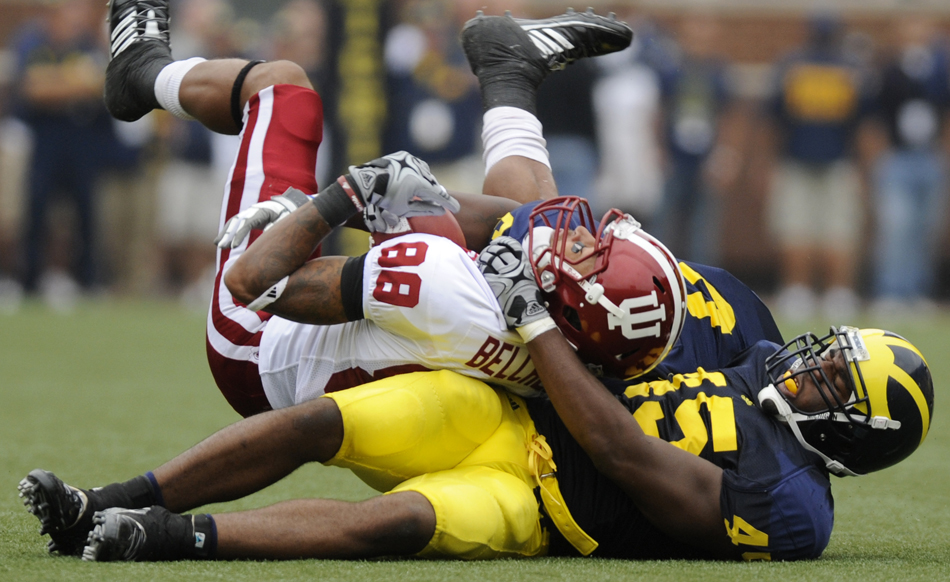 Michigan linebacker Obi Ezeh drags down IU wide receiver Damarlo Belcher from behind during a football game on Saturday, Sept. 26, 2009, in Ann Arbor, Mich.