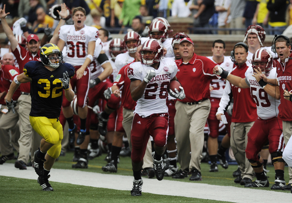 IU running back Darius Willis breaks away from Michigan safety Jordan Kovacs for a 85-yard touchdown late in the fourth quarter of a football game on Saturday, Sept. 26, 2009, in Ann Arbor. IU lost 36-33.