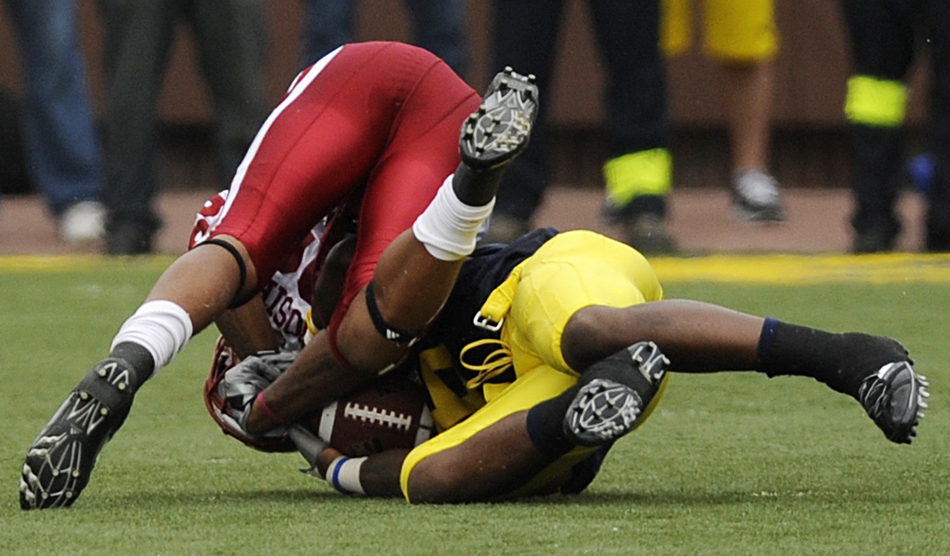 IU wide receiver Damarlo Belcher, left, struggles for the ball with Michigan's Donovan Warren during the fourth quarter of a football game against Michigan on Saturday, Sept. 26, 2009, in Ann Arbor, Mich. Warren came up with the ball, and a review confirmed the officials' call. IU lost 36-33.