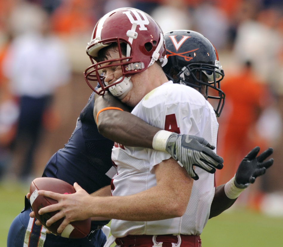 Virginia cornerback Ras-I Dowling puts a hit on IU quarterback Ben Chappell during the first half of a football game on Saturday, Oct. 10, 2009, at Scott Stadium in Charlottesville, Va.