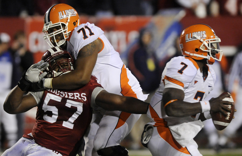 IU defensive end Jammie Kirlew (57) struggles in an attempt to sack Illinois quarterback Juice Williams during a football game on Saturday, Oct. 17, 2009, at Memorial Stadium. Illinois offensive lineman Jeff Allen (71) was called for holding on the play.