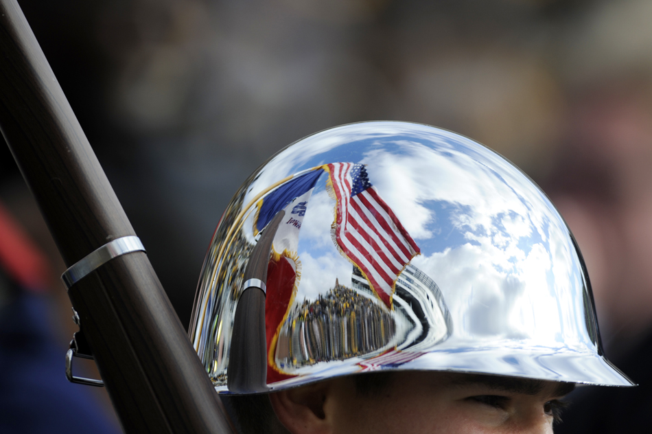 The American Flag is reflected off the helmet of a member of the color guard before a football game between IU and Iowa on Saturday, Oct. 31, 2009, in Iowa City, Iowa.