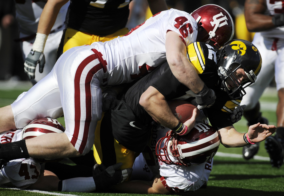 IU linebacker Tyler Replogle (46) pushes Iowa quarterback Ricky Stanzi to the ground for a sack during a football game on Saturday, Oct. 31, 2009, in Iowa City, Iowa.