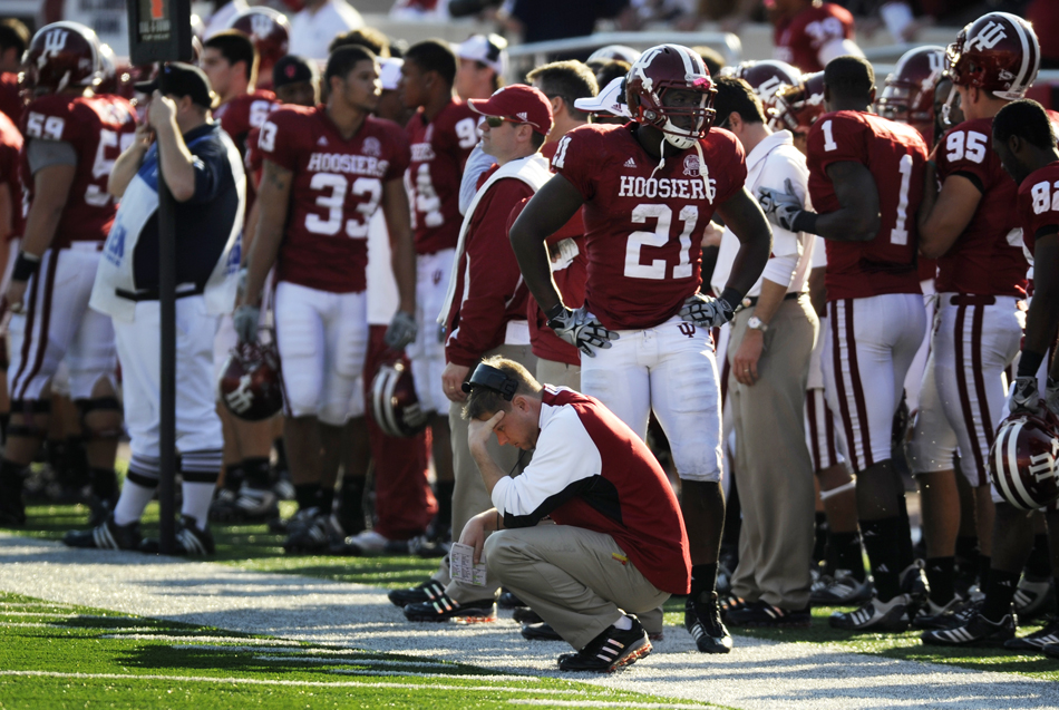 IU wide receivers coach Billy Lynch puts his head down on the sidelines in the closing minutes of a 31-28 loss to No. 24 Wisconsin on Saturday, Nov. 6, 2009, at Memorial Stadium.