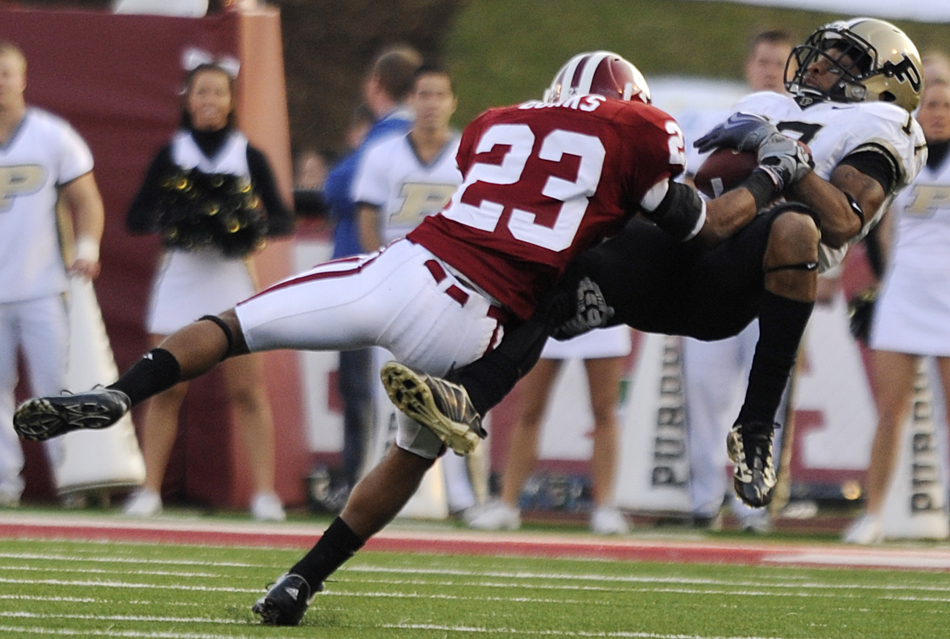 IU cornerback Adrian Burks tackles Purdue wide receiver Aaron Valentin after a catch during a game on Saturday, Nov. 21, 2009, at Memorial Stadium.