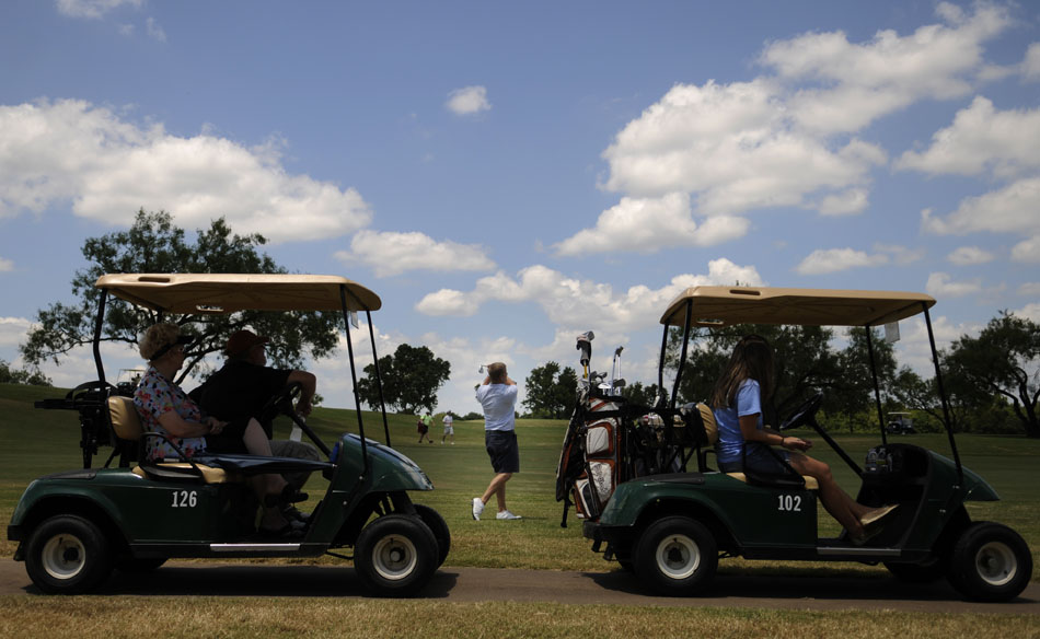 Kody King, middle, hits a second shot from the fairway during the final round of the Austin City Golf Championship at Jimmy Clay Golf Course on Sunday, Aug. 8, 2010.